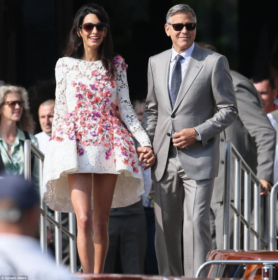 Introducing Mr and Mrs Clooney: George Clooney and his beautiful bride Amal Alamuddin left the Aman Canal Grande in Venice on Sunday after their Saturday nuptials, sporting huge smiles