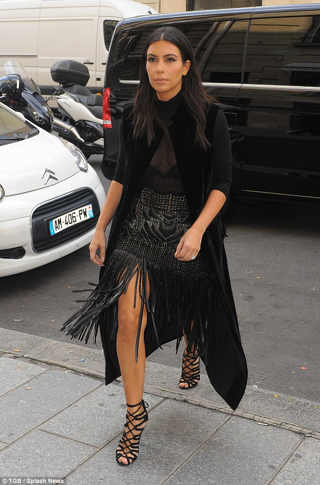 Ready for battle: Kim Kardashian channels Xena Warrior Princess in her leather studded fringed skirt