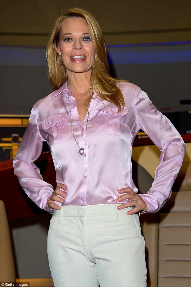 Scifi pinup Jeri Ryan stuns in a silk shirt and high
