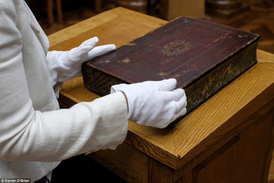 Large folio volume hiding a travelling library of books