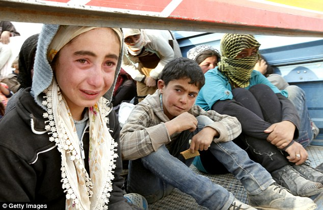Syrian Kurdish refugee girl cries after crossing into Turkey from the Syrian border - ozara gossip