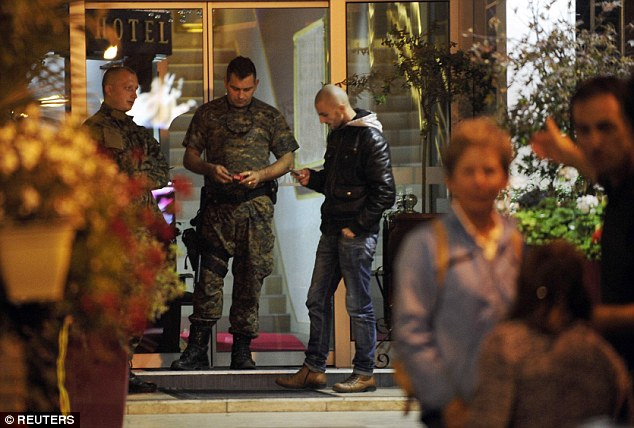 Macedonian police guard the entrance of a quarantined hotel in Skopje. A British man staying there has died of Ebola and his travelling companion has showed symptoms of the disease