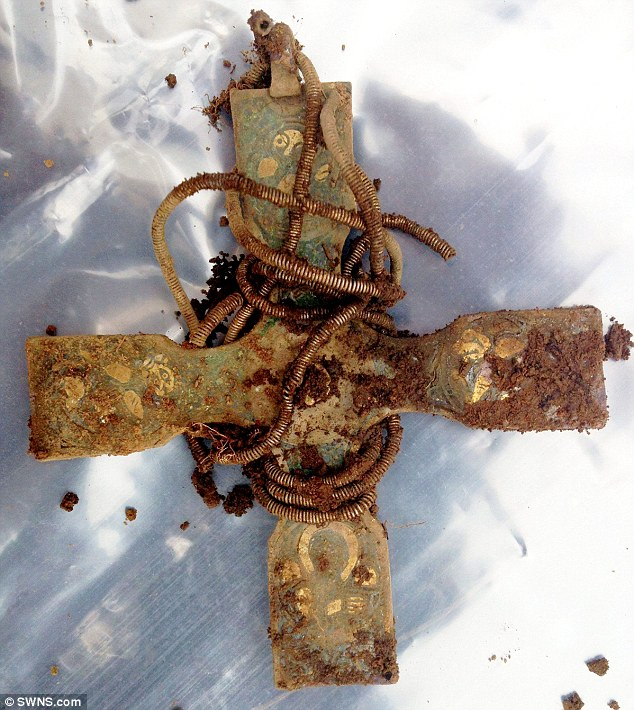 An early medieval cross is among the largest hoard of Viking treasure found in the United Kingdom at an undisclosed location on land owned by the Church of Scotland. The cross is engraved with decorations that, experts say, are highly unusual, which finder Derek McLennan believes may represent the four Gospels
