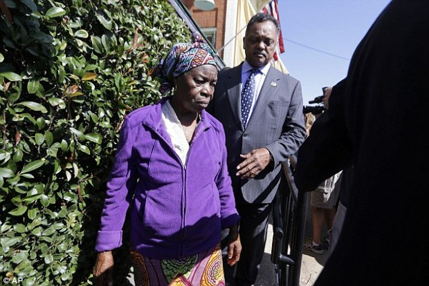 Grief: Nowai Korkoyah, Duncan's mother, speaks to reporters on October 7 - the day before Duncan died. When she saw him hooked up to the machines, barely clinging to life, she wept: 'My son is dead!'