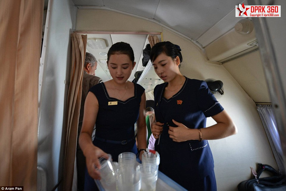 The female flight attendants served drinks from plastic cups. In 2013 some of the attendants' uniforms changed from red and white to navy blue with studded white trim