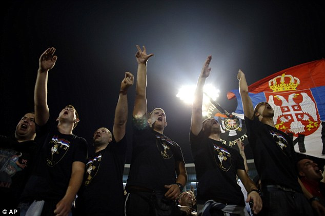 Serbia supporters chant, accompanied by their national flag, before the Group I qualifying match