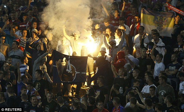 Serbia fans burn a NATO flag during the Group I qualifying game at the Partizan Stadium