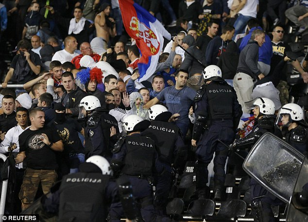 Fans clashed with police as havoc took hold in the stands in Belgrade