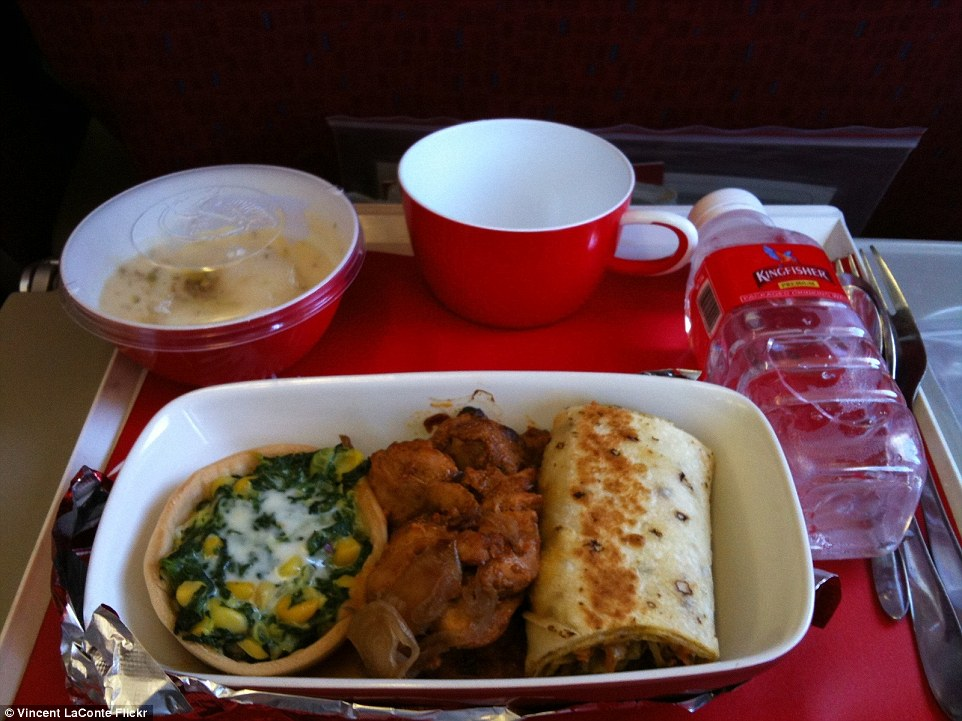 India's now defunct Kingfisher Airlines serves an in-flight meal of  curried chicken and Indian-style bread, roti on the side. There is also a spinach and paneer (Indian cottage cheese) and a creamy rice pudding for dessert