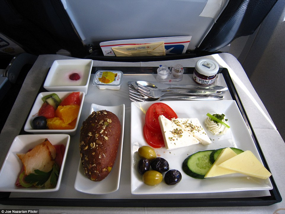 Clean flavours: Turkish Airlines' business class breakfast from Istanbul to Zurich is a simple offering of ham, a bread roll, feta, cucumber and tomato salad with cheese and olives. There is also a fruit salad and a serving of yoghurt as well as a small pot of sour cream