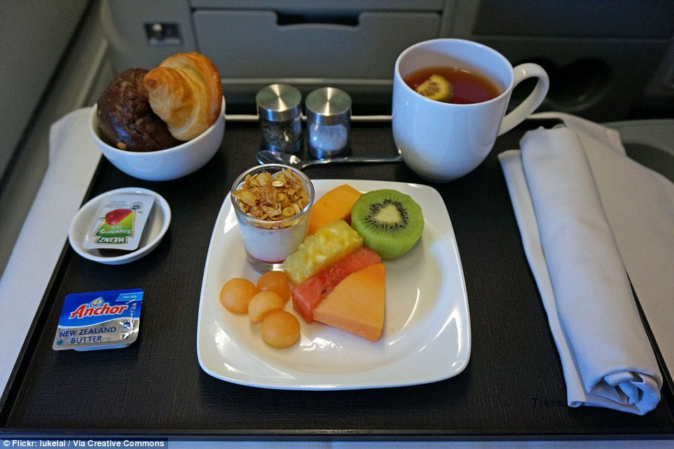 TransAsia Airways: Business class snack of two types of breads, a fruit plate of kiwi, rock melon, pineapple and watermelon, and yoghurt