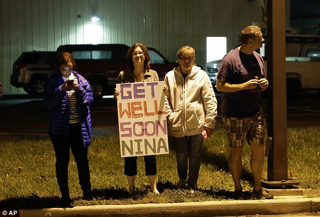 Get well, Nina: Well-wishers gathered outside the airport in Maryland where Ms Pham landed Thursday night