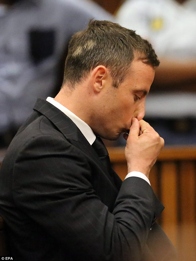 Jailed: Oscar Pistorius reacts as he is handed a five-year prison term for killing his girlfriend Reeva Steenkamp