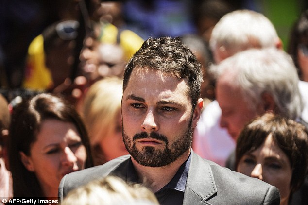 Shock: Oscar Pistorius's brother, Carl, leaves the High Court following his brother's sentencing in Pretoria
