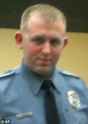 Account: Darren Wilson, the police officer who killed Michael Brown, told how the teenager grabbed his gun