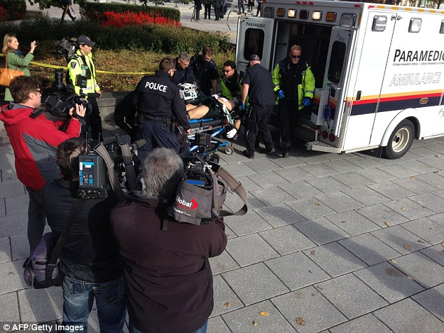 Hurt:  Parliament was placed under lock-down after the gunman opened fire on the soldier, pictured