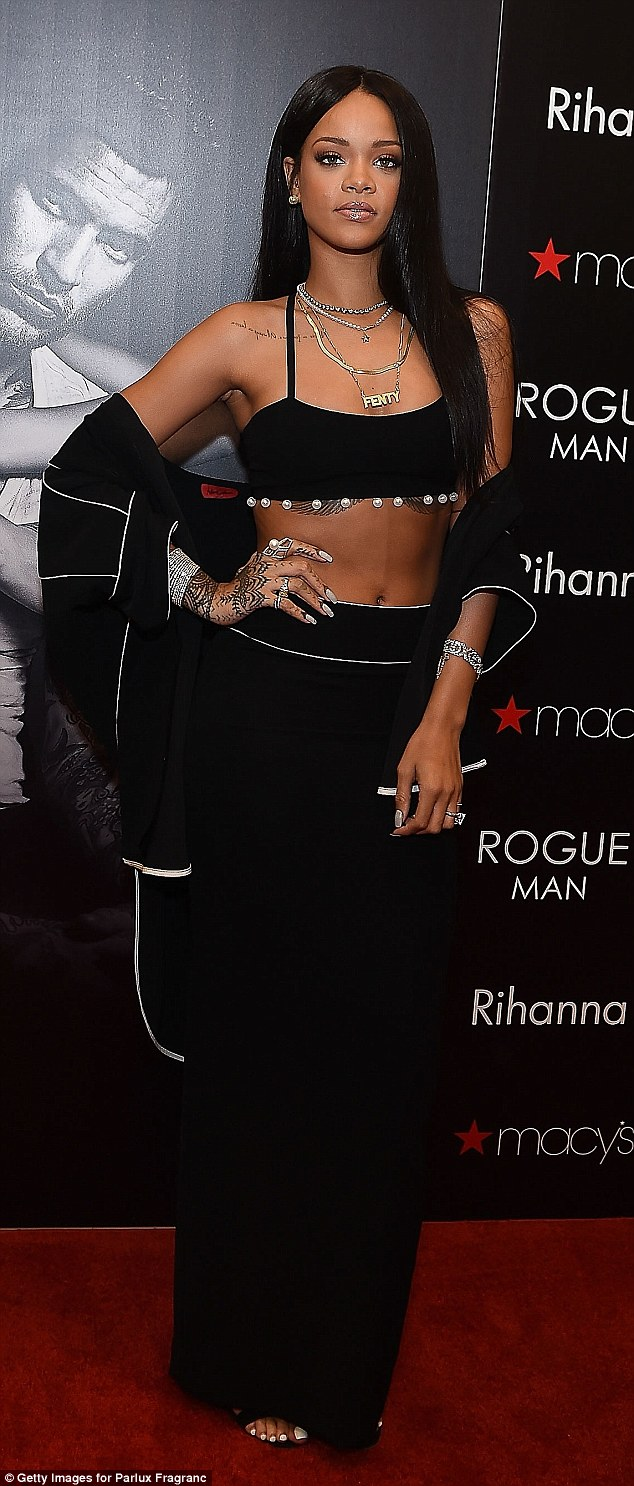 Rihanna flashes some flesh as she launches cologne line at