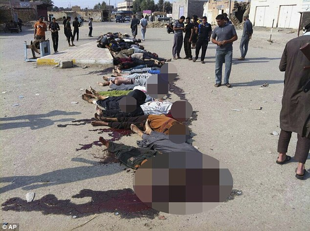 Sickening: ISIS militants lined up 30 Sunni men in a town west of Baghdad and shot them dead this morning