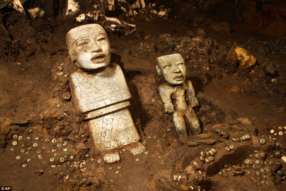 Two of the sculptures unearthed by investigators at the Teotihuacan archeological site in Mexico. Mexican archaeologists have concluded a yearslong exploration of a tunnel sealed nearly 2,000 years ago at the ancient city of Teotihuacan and found 50,000  relics.