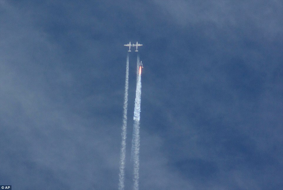 Fatal launch: SpaceShipTwo, left, is seen above moments after it detatched from WhiteKnightTwo, the twin-hulled airplane which carries the main vessel to 45,00ft before dropping it to make the sub-orbital space flight by itself