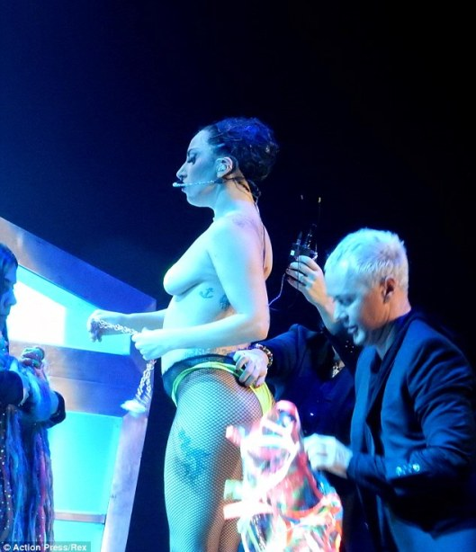 Over exposed: The eccentric star, who is in Vienna as part of her artRave: The ARTPOP Ball world tour, was pictured showing off her shapely derriere dressed in a neon coloured G-string and fishnet stockings