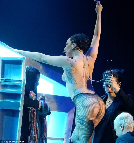 So much flesh: Keeping some modesty with white nipple guards, the pop sensation oozed heaps of sex appeal as she put in the final few touches ahead of her X-rated performance