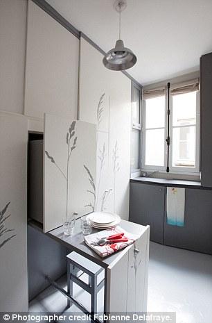 Teeny Parisian apartment contains foldaway wardrobe bed