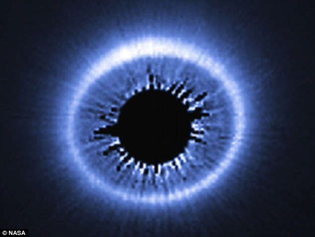 Captured by the Hubble Space Telescope, this image shows the huge dusty debris discs arounda star called HD 181327, showing a huge spray of debris possibly caused by the recent collision of two bodies into the outer part of the system.