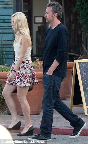 Matthew Perry and mystery blonde in a mini skirt light up
