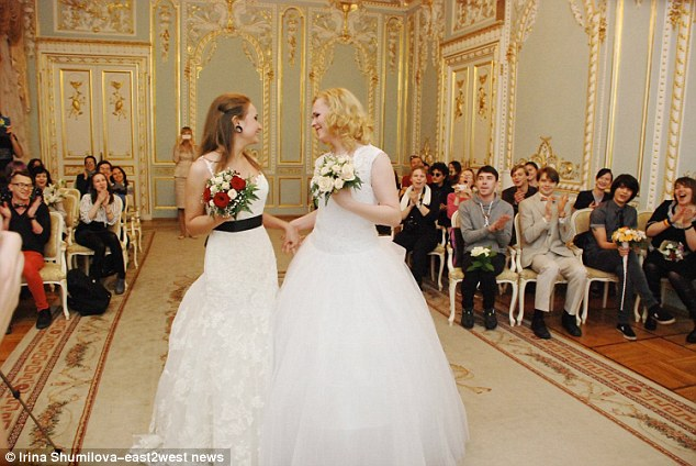 The couple are cheered on by their friends and family as they celebrated their wedding over the weekend at a beautiful registry office in Russua