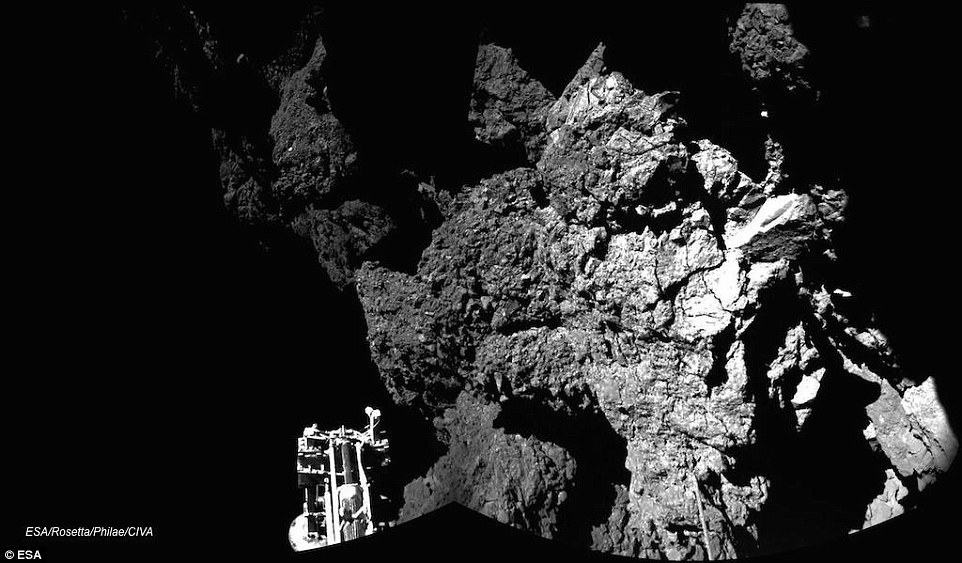 This was one of the first pictures return by Philae from the surface of comet 67P. Today scientists said they are 'very confident' it will 'wake up' when the comet moves into an orbit where more sunlight hits is solar panels in a few months.