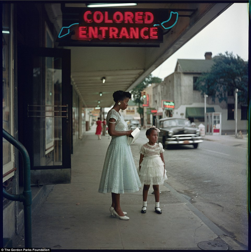 The image taken outside a department store in downtown Mobile, Alabama shows the colored entrance during segregation. While only 20 photos ran in the original Life photo-essay, the exhibit will feature 40 of Parks' shots from the series