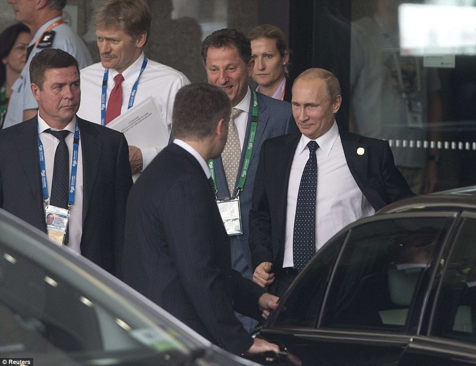 Mr Putin travelled in a motorcade to the airport and boarded his plane immediately following the briefing