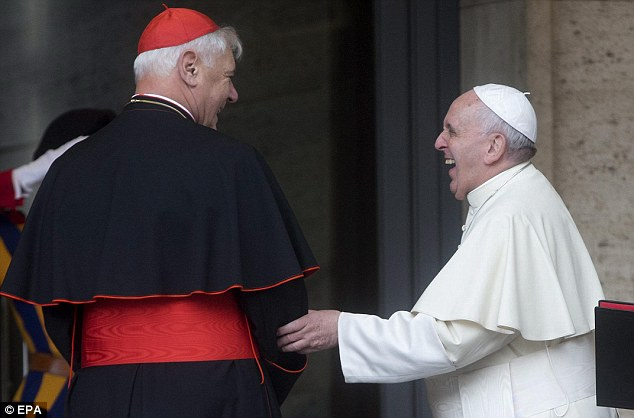 Pope Francis laughs with Cardinal Gerhard Ludwig Mueller at the Congregation for the Docrtrine of the Faith About Marriage today