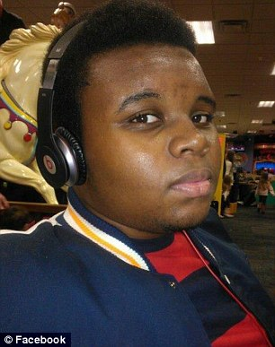 Killed: Michael Brown, 18, was shot dead by a police officer in August. A grand jury is deciding whether to indict his killer