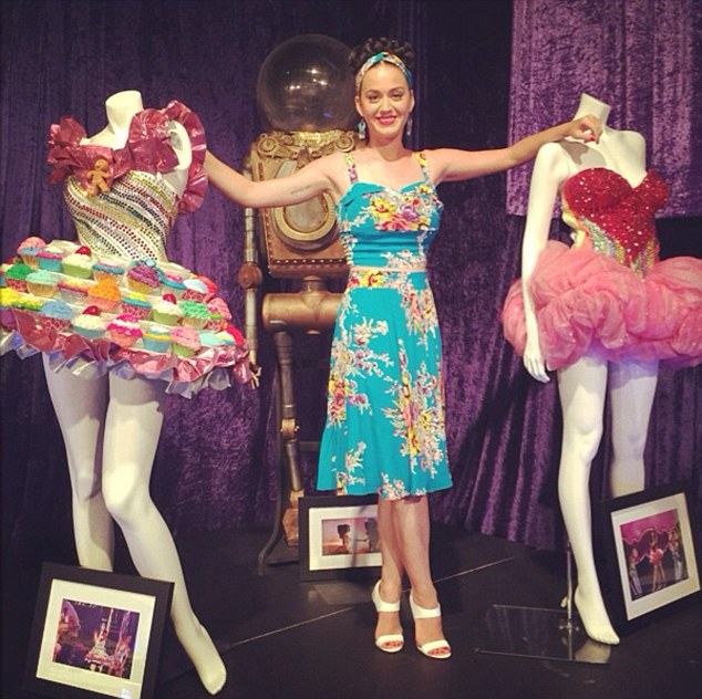 Memories: Katy Perry took to Instagram on Friday to share a shot of herself posing with old tour costumes at her temporary pop-up store in Sydney, Australia
