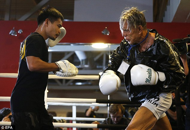 Mickey Rourke And Rival Strip For Weigh In Ahead Of Boxing