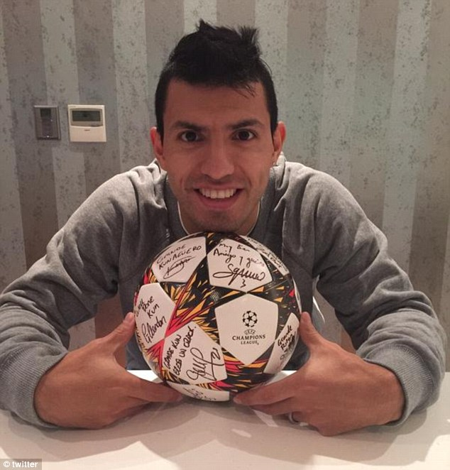 Sergio Aguero smiles for the camera as he poses with the match ball after his Manchester City hat-trick