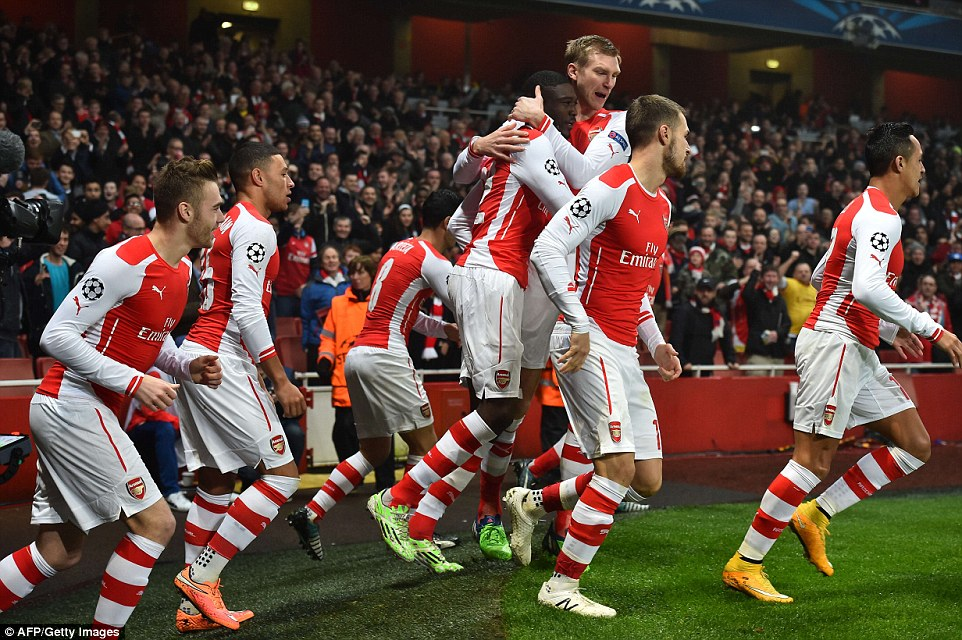 The Arsenal players celebrates the French youngster's early goal in the Champions League Group D clash