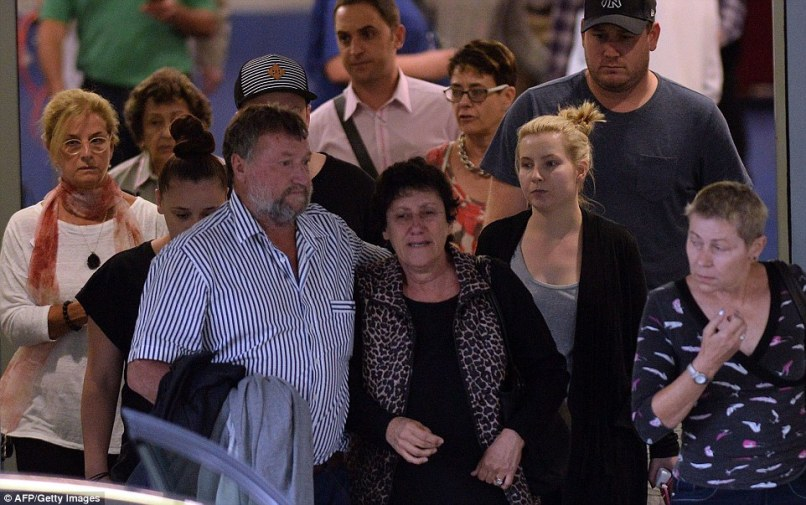 Family leaves: Hughes' distraught father Greg (centre), mother Virginia (second on the right) and other relatives leave St Vincent's Hospital
