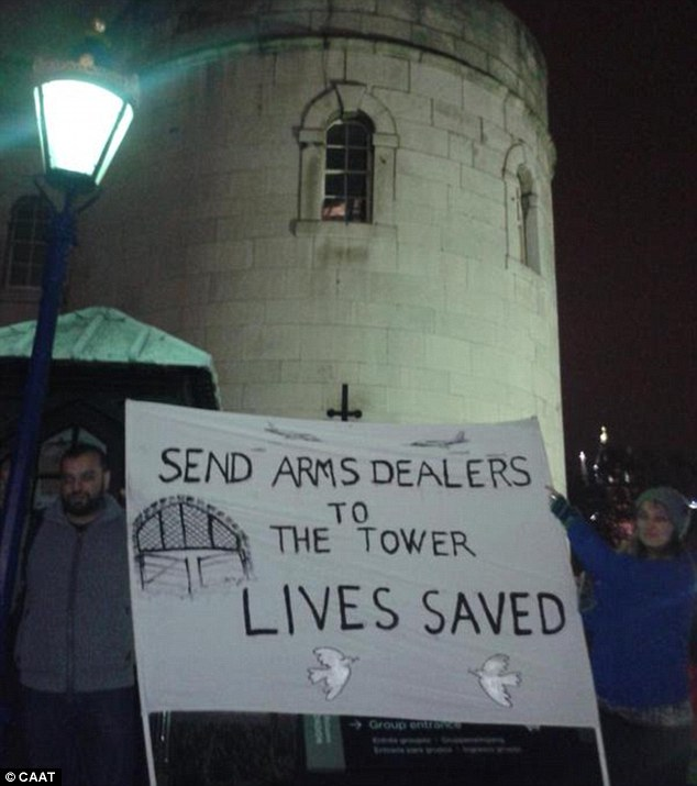 Protesters met arms dealers at the Tower of London as they arrived for a 'luxurious' three-course dinner just yards from the poppy memorial, which is still being removed
