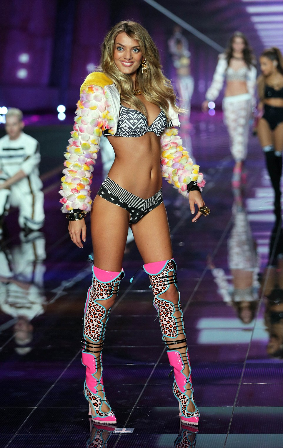Over the knee funk: They teamed leopard print lace-up knee boots with their tiny items of lingerie and pom-pom jackets