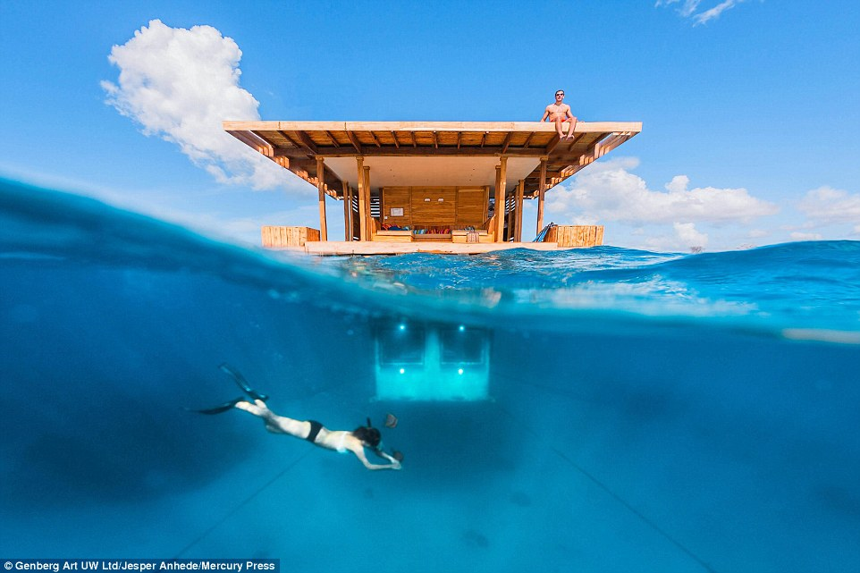 Guests can have their own window on the Indian Ocean at the Manta Resort, and wave hello to divers