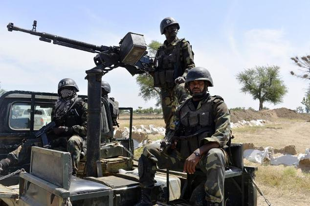 Cameroonian soldiers patrol Amchide, Cameroon, on November 12, 2014, a city that was raided by Islamists from Nigeria's Boko Haram a month earlier, killing e...