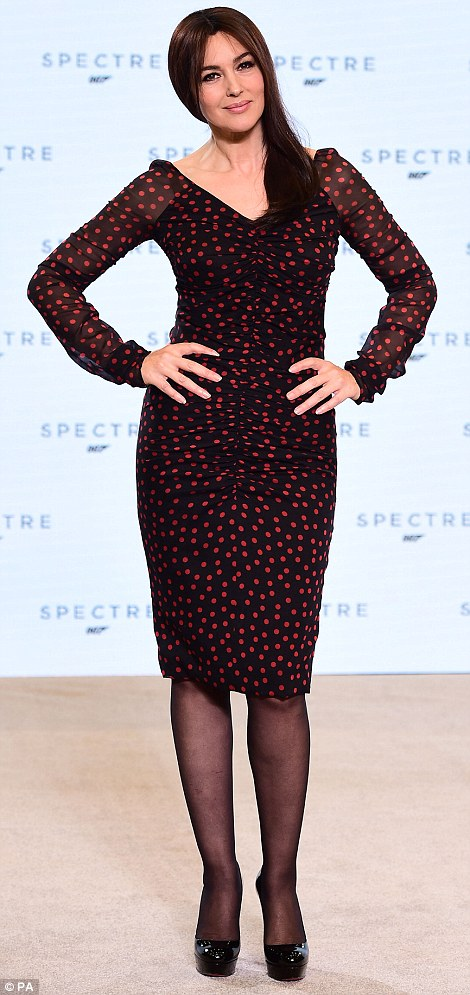 Stepping out in style: Monica, who showed off her curvaceous figure in a fitted black and red dress, may be the oldest Bond girl ever but she is also one of the most glamorous, while Lea put on her best sartorial displays for the big announcement