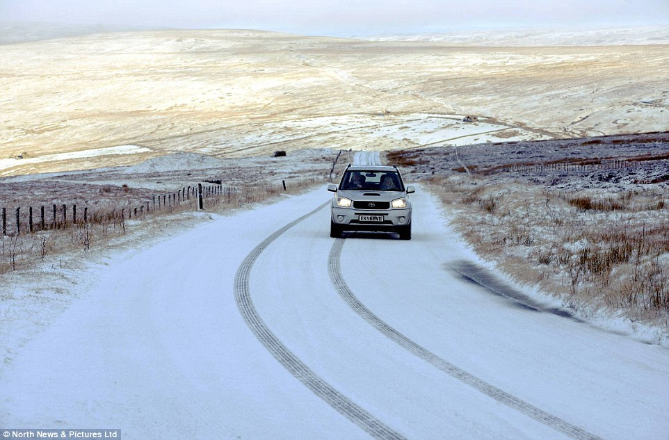 Tricky: Heavy snowfall made for difficult driving conditions in some parts of northern England and Scotland today, including Northumberland