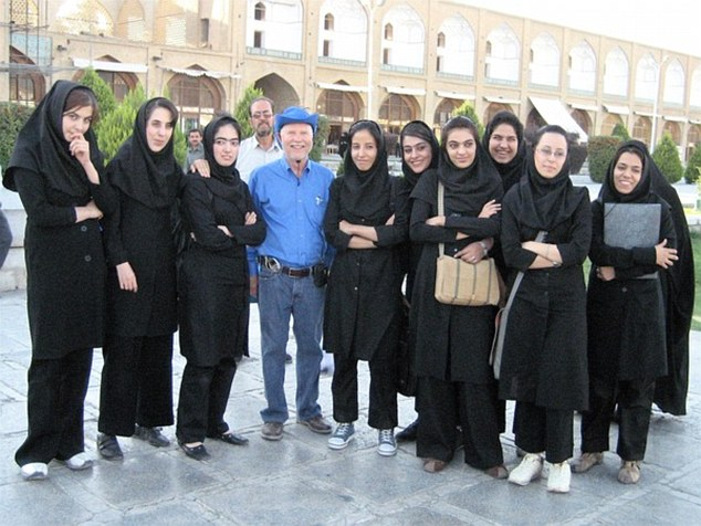 Donald poses with Nine Virgins in Isfahan, Iran in 2006. During his life, Mr Parrish has discovered that he has spent a total of eight years outside of the US traveling or working