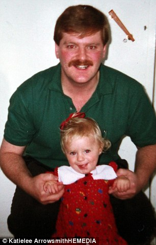 Miss Reynolds with her father Michael when she was 13 months old