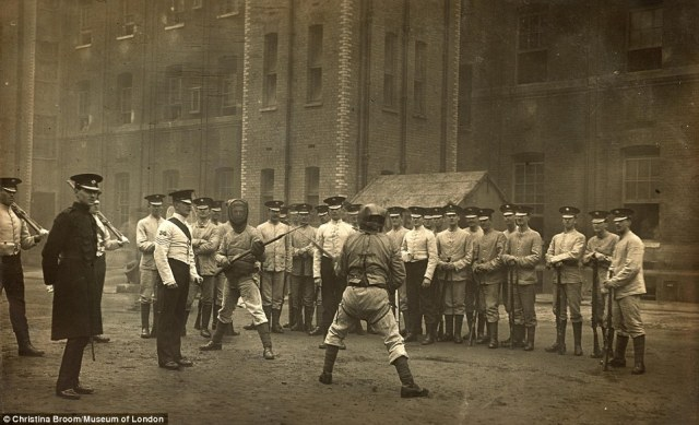 An early photo, taken in 1911 of the 1st Irish Guards at bayonet practice at Chelsea Barracks would have been printed and sold as a postcard