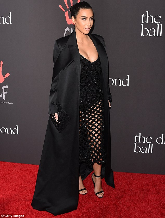 Never under-dressed: Kim looked utterly incredible as she worked her magic on the red carpet, ensuring her world-famous figure was on full display for the occasion